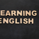 Learning English spelled with wooden letters on black background - PhotoDune Item for Sale
