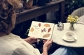 Caucasian woman relaxing while reading a book - PhotoDune Item for Sale