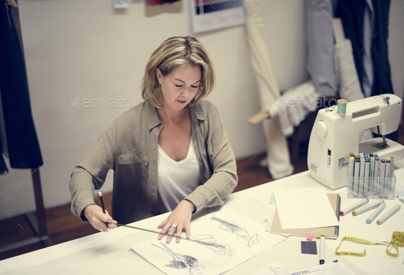 Woman working on a project - Stock Photo - Images