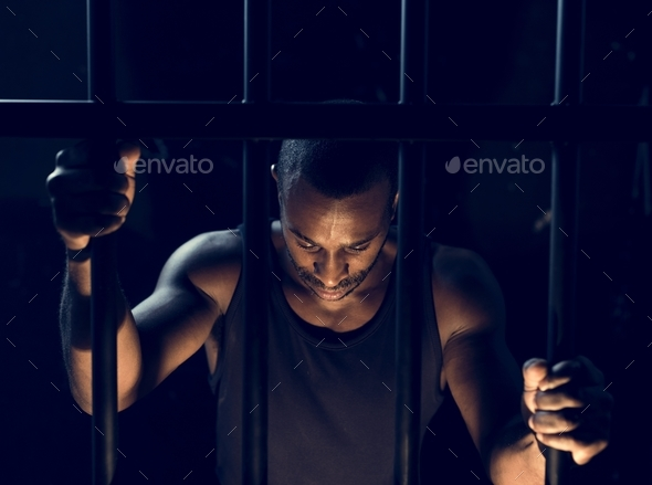 A man arrest in the jail - Stock Photo - Images