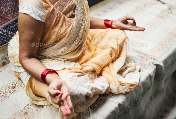 A meditating Indian woman - Stock Photo - Images