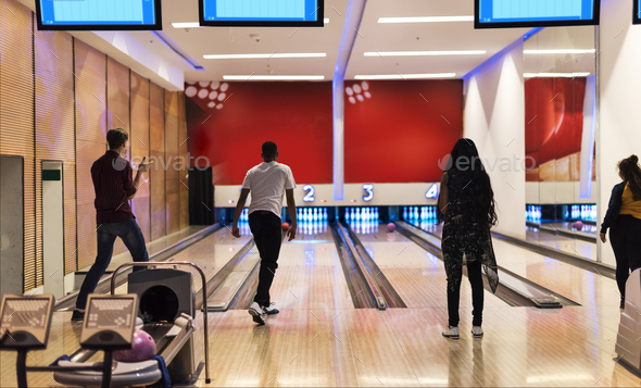 Friends at the bowling alley together - Stock Photo - Images