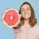 Cute Happy Smiling Woman Holds Pink Grapefruit - VideoHive Item for Sale