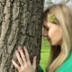A Young Woman Touches a Tree. Rest, Tranquility, Unity with Nature and Harmony. - VideoHive Item for Sale