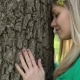 A Young Woman Touches a Tree - VideoHive Item for Sale
