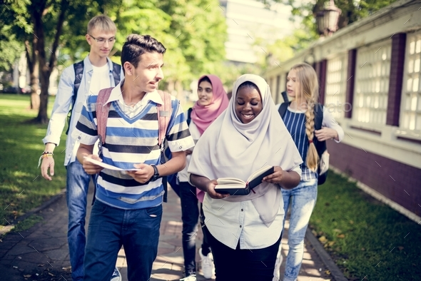 Diverse children studying outdoor - Stock Photo - Images