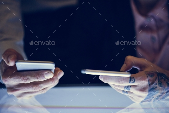 Hands with tattoo holding smartphone - Stock Photo - Images