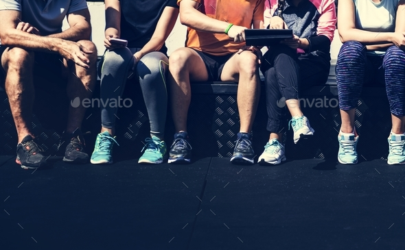 Group of diverse athletes sitting together - Stock Photo - Images