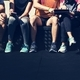 Group of diverse athletes sitting together - PhotoDune Item for Sale