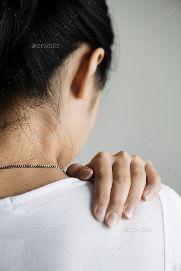 Asian woman suffering back pain - Stock Photo - Images
