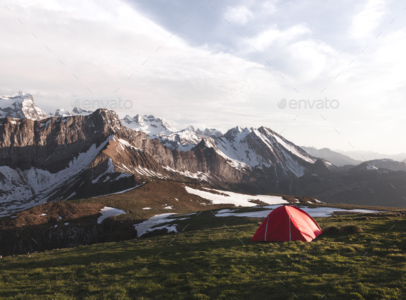 Tent in front of a Mountain Ridge in Switzerland Stock Photo by DinoReichmuth