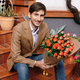 Smiling handsome man holding a bunch of roses - PhotoDune Item for Sale