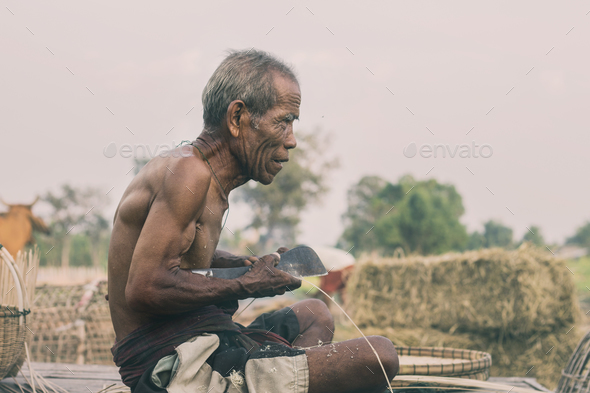 Old man on bamboo mat - Stock Photo - Images