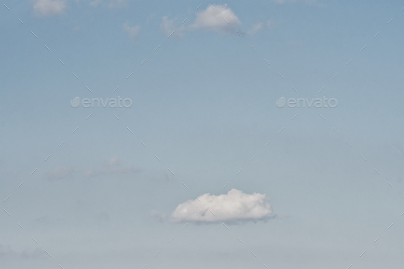 Clear blue sky with plain white cloud with space for text background - Stock Photo - Images