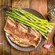 grilled barbecue steak with green asparagus, on rustic wood - PhotoDune Item for Sale