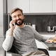 Handsome bachelor 30s with beard having mobile conversation, whi - PhotoDune Item for Sale