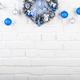 Christmas blue and silver balls and wreath on white brick wall h - PhotoDune Item for Sale