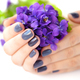 Hands of a woman with dark manicure on nails and bouquet of viol - PhotoDune Item for Sale