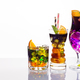 Selection of colorful festive drinks, alcoholic beverages and cocktails in elegant glasses on white - PhotoDune Item for Sale