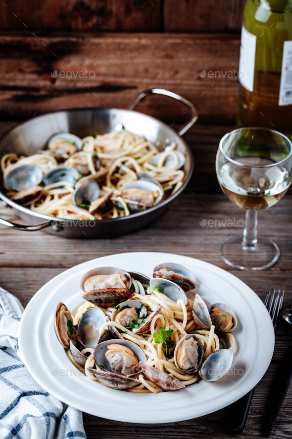 Traditional italian seafood pasta with clams Spaghetti alle Vongole - Stock Photo - Images