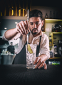 Bartender adding ginger into a glass - PhotoDune Item for Sale