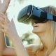 Young Woman in a Helmet of Virtual Reality. Touching Invisible Wall - VideoHive Item for Sale