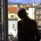 Young Woman Opening Window at Morning in Italian Medieval Town - VideoHive Item for Sale