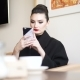 Young Businesswoman Using Smartphone and Drinking Coffee - VideoHive Item for Sale