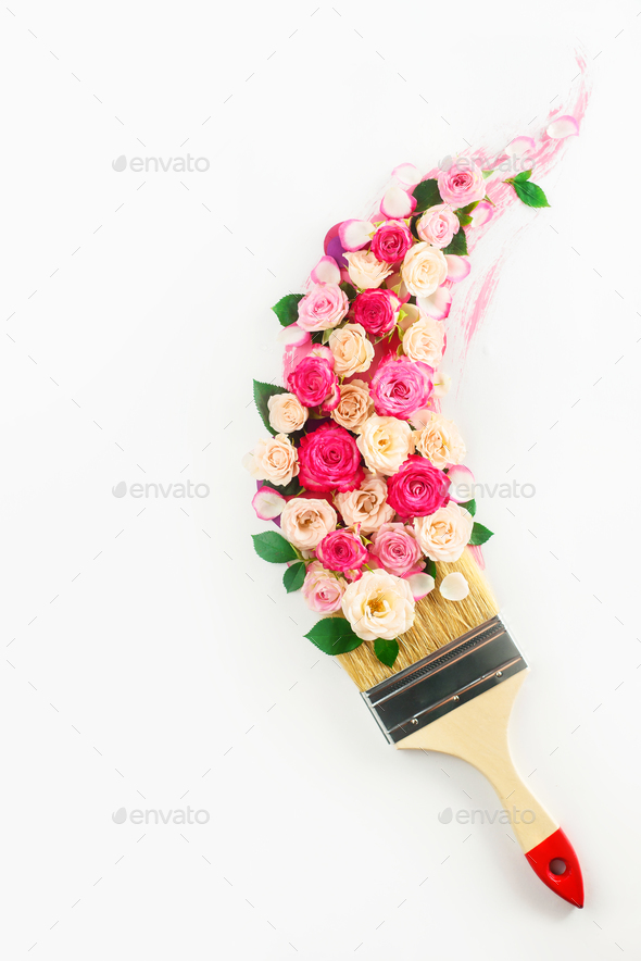Flower arrangement following a trace of a brush. Spring time and home decoration conceptual flat lay - Stock Photo - Images