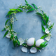 Easter wreath with eggs, green leaves and spring flowers. Floral decoration concept with copy space. - PhotoDune Item for Sale
