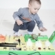 Little Baby Boy Intently Playing with Busy Board - VideoHive Item for Sale