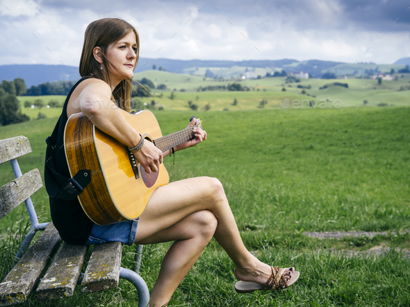 Woman Playing Guitar On A Park Bench Stock Photo By Sumners Photodune