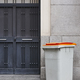 Garbage can on an urban building entrance door. Clean environment - PhotoDune Item for Sale