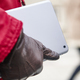 Woman holding a tablet in a city downtown. Winter time - PhotoDune Item for Sale