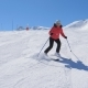 Mature Fat Woman Alpine Skier Professionally Carving Down The Slope In Mountains - VideoHive Item for Sale