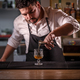Bartender is pouring alcohol - PhotoDune Item for Sale