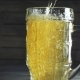 Shot of Pouring Beer Into Beer Mug. Over Dark Wooden Background - VideoHive Item for Sale