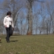 Mature Woman Walks in Park with Her Little Dog - VideoHive Item for Sale