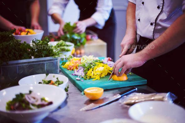 team cooks and chefs preparing meals - Stock Photo - Images