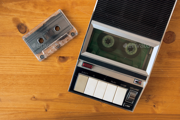 Audio cassette tape rolling in vintage player - Stock Photo - Images