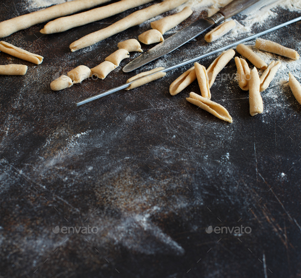 Making whole wheat flour pasta Maccheroni al ferro - Stock Photo - Images