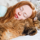 Young redhair woman sleeping with cat - PhotoDune Item for Sale