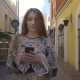 Young Girl Walking Down the Street with a Phone in Hands - VideoHive Item for Sale