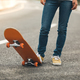 Skateboarder with skateboard on highway ready for riding - PhotoDune Item for Sale