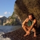 Brave Adventurist Man Is Playing Hapr Barefoot on the Slope of Sharp Island Limestone Cave - VideoHive Item for Sale
