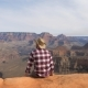 A Hiker Man Sits, Watching A Breathtaking View Of Grand Canyon Alone - VideoHive Item for Sale
