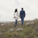 Back View of Lovely Couple Walking on the Rock in Windy Day. - VideoHive Item for Sale
