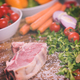 Juicy slice of raw steak on wooden table - PhotoDune Item for Sale