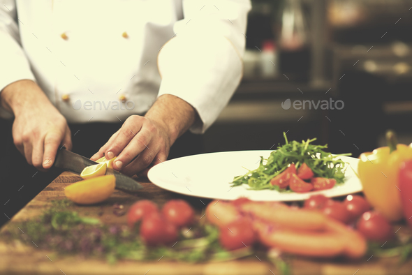 chef serving vegetable salad - Stock Photo - Images