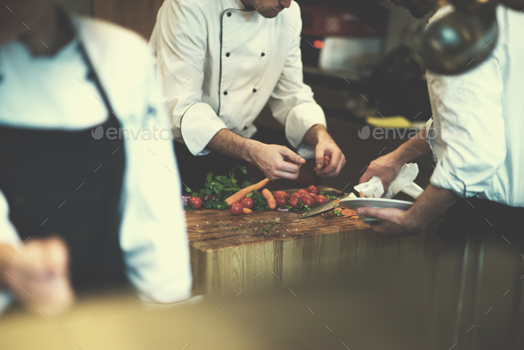 team cooks and chefs preparing meal - Stock Photo - Images